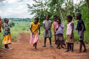 children playing on gravel road